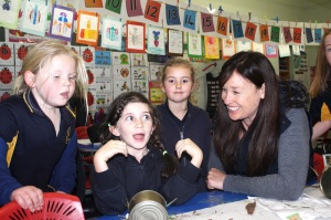 Leading teacher and La Trobe alumna Judy GIbbs makes mini beast houses with her young students.