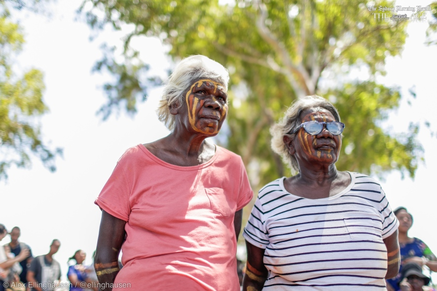 Jacinta Tipungwut and Regina Kantilla listen as Opposition Leader Bill Shorten speaks during a community bbq with the Wurrumiyanga community on Bathurst Island, NT, on Thursday 18 April 2019. Opposition Leader Bill Shorten's campaign during the 2019 Federal Election. fedpol ausvotes19 election19 Photo: Alex Ellinghausen